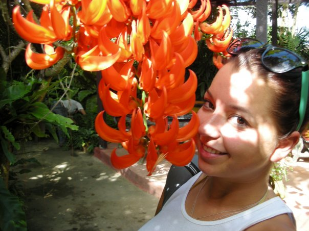Posing with some more orchids in Thailand
